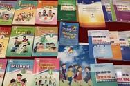 Lựa chọn sách giáo khoa lớp 1- Bộ đang làm khó các nhà trường!