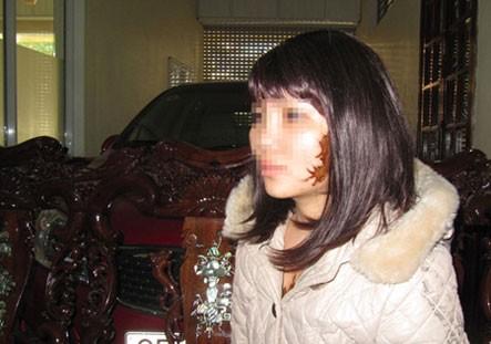 Cô gái Nguyễn Thị G và hình xăm hình quái thú trên mặt