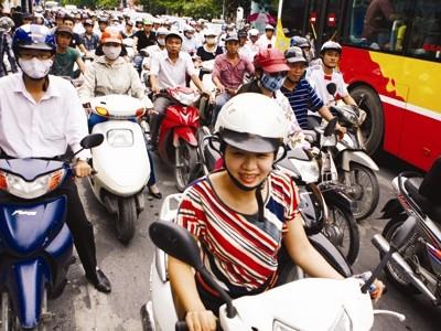 Đề án hạn chế xe cá nhân nhằm vào xe máy đang gây ra nhiều luồng ý kiến khác nhau. Ảnh: Hồng Vĩnh